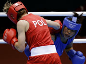 Poland`s Karolina Michalczuk, left, and fights India`s Chungneijang Mery Kom Hmangte, fight during the women`s flyweight boxing competition at the 2012 Summer Olympics.