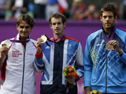From left, silver medalist Switzerland`s Roger Federer, gold medalist Andy Murray of Great Britain, and bronze medalist Juan Martin del Potro of Argentina stand during the medal ceremony of the men`s singles event at the All England Lawn Tennis Club at Wimbledon, in London.