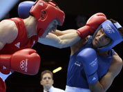 Thomas Stalker of Great Britain, left, and Manoj Kumar of India, fight during the men`s light welterweight boxing competition at the 2012 Summer Olympics