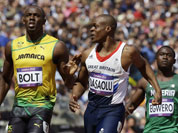Jamaica`s Usain Bolt, left, reacts after winning ahead of Nigeria`s Ogho-Oghene Egwero, right, and Britain`s James Dasaolu in a men`s 100-meter heat during the athletics in the Olympic Stadium at the 2012 Summer Olympics.