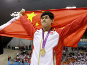 China`s Sun Yang holds his national flag as he celebrates his gold medal win in the men`s 1500-meter freestyle swimming final at the Aquatics Centre in the Olympic Park during the 2012 Summer Olympics.