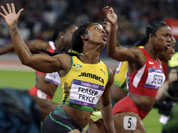 Gold medal winner, Jamaica`s Shelly-Ann Fraser-Pryce, left, crosses the finish line ahead of silver medal winner United States` Carmelita Jeter during the women`s 100-meter final during athletics competition in the Olympic Stadium at the 2012 Summer Olympics.