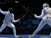 Alaaeldin Abouelkassemn of Egypt competes against James-Andrew Davis of Great Britain, right, during the men`s foil team fencing competition at the 2012 Summer Olympics.