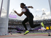 India`s Krishna Poonia competes in the women`s discus throw during athletics competition in the Olympic Stadium at the 2012 Summer Olympics.