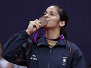 India`s Saina Nehwal kisses his bronze medal of the badminton women`s singles at the 2012 Summer Olympics, Saturday, Aug. 4, 2012, in London.