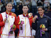 Gold medalist Li Xuerui, center, silver medalist Wang Yihan, left, both from China, and bronze medalist Saina Nehwal of India, pose at the podium of the badminton women`s singles at the 2012 Summer Olympics.
