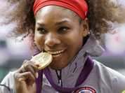 Gold medalist United States` Serena Williams pose during the podium ceremony of the women`s singles final match at the All England Lawn Tennis Club at Wimbledon, in London, at the 2012 Summer Olympics