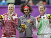 From left, silver medalist Maria Sharapova of Russia, gold medalist Serena Williams of the United States and bronze medalist Victoria Azarenka of Belarus stand on the podium during the medal ceremony of the women`s singles final match at the All England Lawn Tennis Club at Wimbledon