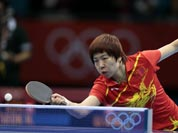 China`s Li Xiaoxia competes against South Korea`s Seok Hajung during a women`s team table tennis semifinal match at the 2012 Summer Olympics.