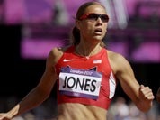 United States` Lolo Jones, left, and Canada`s Phylicia George compete in a women`s 100-meter hurdles heat during the athletics in the Olympic Stadium at the 2012 Summer Olympics.