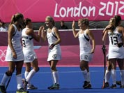 New Zealand players celebrate after qualifying for semifinals following a scoreless women`s hockey match against Germany at the 2012 Summer Olympics.