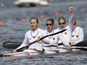 Germany`s, left to right, Carolin Leonhard, Franziska Weber, Katrin Wagner-Ausutrin and Tina Dietze celebrate after winning a women`s kayak four 500m heat in Eton Dorney, near Windsor, England, at the 2012 Summer Olympics.