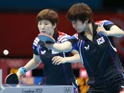 South Korea`s Seok Hajung, right, and Dang Yeseo compete against China`s Yue Guo and Li Xiaoxia during a women`s team table tennis semifinal match at the 2012 Summer Olympics.