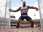Britain`s Lawrence Okoye takes a throw in a men`s discus throw qualification round during the athletics in the Olympic Stadium at the 2012 Summer Olympics.