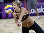 Laura Ludwig of Germany digs out a ball near the end of a two set loss to Brazil during a beach volleyball match at the 2012 Summer Olympics.