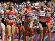 Turkey`s Gamze Bulut celebrates as she crosses the finish line to win her women`s 1500-meters heat during the athletics in the Olympic Stadium at the 2012 Summer Olympics.