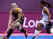South Africa`s Bernadette Coston , left, and Kayla Bashore Smedley vie for the ball in the preliminary round women`s hockey match at the 2012 Summer Olympics.