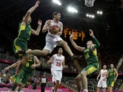 Tunisia`s Mourad El Mabrouk, center, looks to pass as he leaps between Lithuania defenders Mantas Kalnietis, left, and Paulius Jankunas (15) during a preliminary men`s basketball game at the 2012 Summer Olympics.