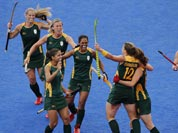 South Africa players celebrate a goal against the United States during their preliminary round women`s hockey match at the 2012 Summer Olympics.
