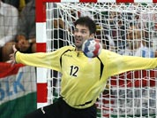 Serbia`s Darko Stanic, right, fails to save a shot by Hungary`s Tamas Mocsai, left, during their men`s handball preliminary match at the 2012 Summer Olympics.