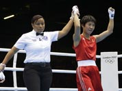 China`s Ren Cancan, right, celebrates after defeating Russia`s Elena Savelyeva, left, in a women`s flyweight 51-kg quarterfinal boxing match at the 2012 Summer Olympics.