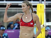 Kerri Walsh Jennings of the United States reacts after blocking the shot of Italy`s Marta Menegatti, right, during a beach volleyball match at the 2012 Summer Olympics.