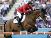 Japan`s Taizo Sugitani rides Avenzio during the equestrian show jumping competition at the 2012 Summer Olympics.