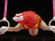 Chinese gymnast Chen Yibing performs on the rings during the artistic gymnastics men`s apparatus finals at the 2012 Summer Olympics.