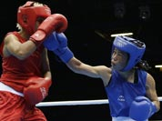 Chungneijang Mery Kom Hmangte, right, fights Tunisia`s Maroua Rahali during a women`s flyweight 51-kg quarterfinal boxing match at the 2012 Summer Olympics.
