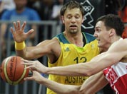 Russia`s Sasha Kaun, right, passes as he is pressured by Australia`s David Andersen during a men`s basketball game at the 2012 Summer Olympics.