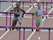 Belgium`s Eline Berings, left, Bahamas` Ivanique Kremp, center, and Kazakhstan`s Anastassiya Pilipenko, right, compete in a women`s 100-meter hurdles heat during the athletics in the Olympic Stadium at the 2012 Summer Olympics.