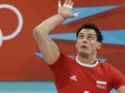 Poland`s Zbigniew Bartman (9) serves the ball to Australia during a men`s volleyball preliminary match at the 2012 Summer Olympics.