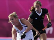 New Zealand`s Ella Gunson, front, plays a shot as Germany`s Celine Wild watches in their preliminary round women`s hockey match at the 2012 Summer Olympics.