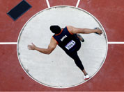 India`s Vikas Gowda competes in the men`s discus qualification during athletics competitions at the 2012 Summer Olympics at the Olympic Stadium in London.