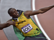 Jamaica`s Usain Bolt wears his national flag following his win in the men`s 100-meter final during the athletics in the Olympic Stadium at the 2012 Summer Olympics, London.