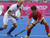 Netherlands` Floris Evers, and South Korea`s Jang Jong-hyun vie for the ball in the preliminary round hockey match at the 2012 Summer Olympics in London.