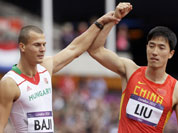 China`s Liu Xiang, and Hungary`s Balazs Baji, react after Liu`s fall in a men`s 110-meter hurdles heat during the athletics in the Olympic Stadium at the 2012 Summer Olympics, London.