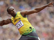 Jamaica`s Usain Bolt gestures before competing in a men`s 200-meter heat during the athletics in the Olympic Stadium at the 2012 Summer Olympics, London.