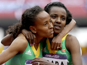 Ethiopia`s Meseret Defar, embraces compatriot Ethiopia`s Tirunesh Dibaba after competing in a women`s 5000-meter heat during the athletics in the Olympic Stadium at the 2012 Summer Olympics, London.