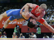 Lithuania`s Edgaras Venckaitis is lifted off the mat by Kazakhstan`s Darkhan Bayakhmetov (in blue) during their match in 66-kg Greco-Roman wrestling competition at the 2012 Summer Olympics, in London.
