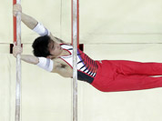 Japanese gymnast Kazuhito Tanaka performs on the parallel bars during the artistic gymnastics men`s apparatus finals at the 2012 Summer Olympics in London.