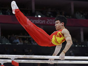 Chinese gymnast Feng Zhe performs on the parallel bars during the artistic gymnastics men`s apparatus finals at the 2012 Summer Olympics in London.