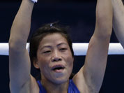 India`s Chungneijang Mery Kom Hmangte celebrates after defeating Tunisia`s Maroua Rahali in a women`s flyweight 51-kg quarterfinal boxing match at the 2012 Summer Olympics.