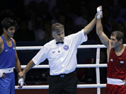 Uzbekistan`s Abbos Atoev, right, defeats India`s Vijender Singh in a middleweight 75-kg quarterfinal boxing match at the 2012 Summer Olympics.