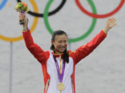 Xu Lijia of China celebrates her gold medal after the Laser radial sailing race at the London 2012 Summer Olympics.