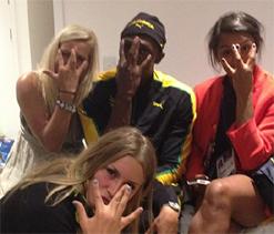 Usain Bolt parties with Swedish women handball players after 100m win