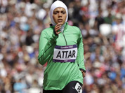 Saudi Arabia`s Sarah Attar competes in a women`s 800-meter heat during the athletics in the Olympic Stadium at the 2012 Summer Olympics, London.