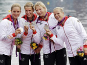 Germany`s, left to right, Carolin Leonhard, Franziska Weber, Katrin Wagner-Augus, and Tina Dietze pose after they won the silver medal for the women`s kayak four 500m in Eton Dorney, near Windsor, England, at the 2012 Summer Olympics.
