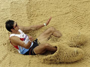 Japan`s Keisuke Ushiro competes in the men`s decathlon long jump during the athletics in the Olympic Stadium at the 2012 Summer Olympics in London