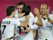 German players congratulate their teammate Christopher Zeller, center back facing camera, for scoring a goal against New Zealand during a preliminary round men`s hockey match at the 2012 Summer Olympics.